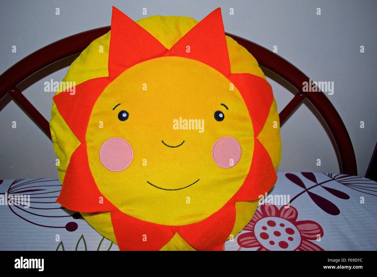 Sunflower pillow with yellow color and smiley - Stock Image
