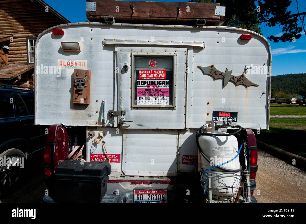 Right-wing bumper stickers on the back of a truck camper from Idaho - Stock Image