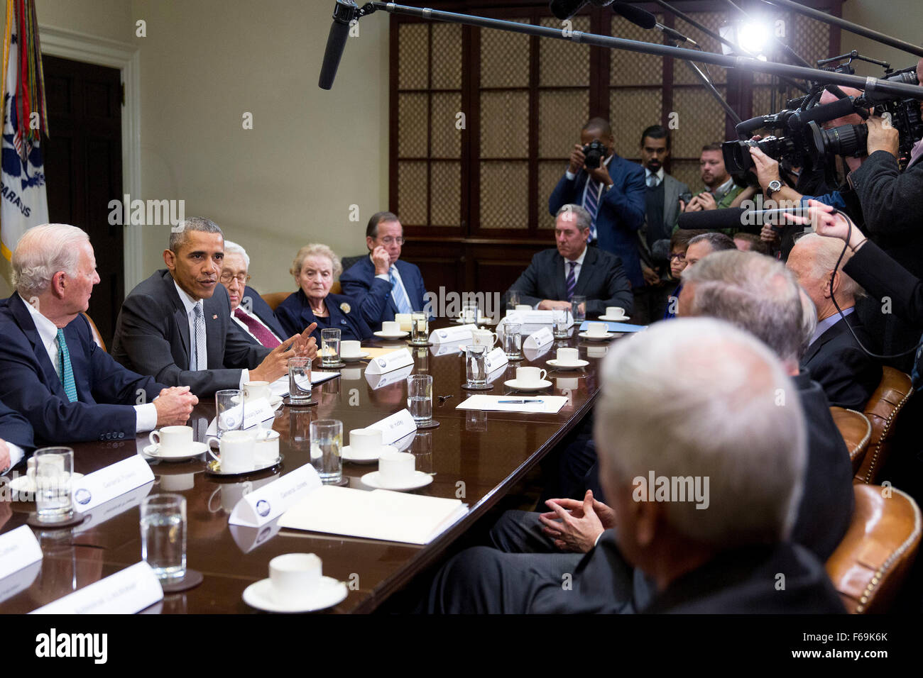 United States President Barack Obama, second left, speaks while meeting with current and former diplomatic and national - Stock Image
