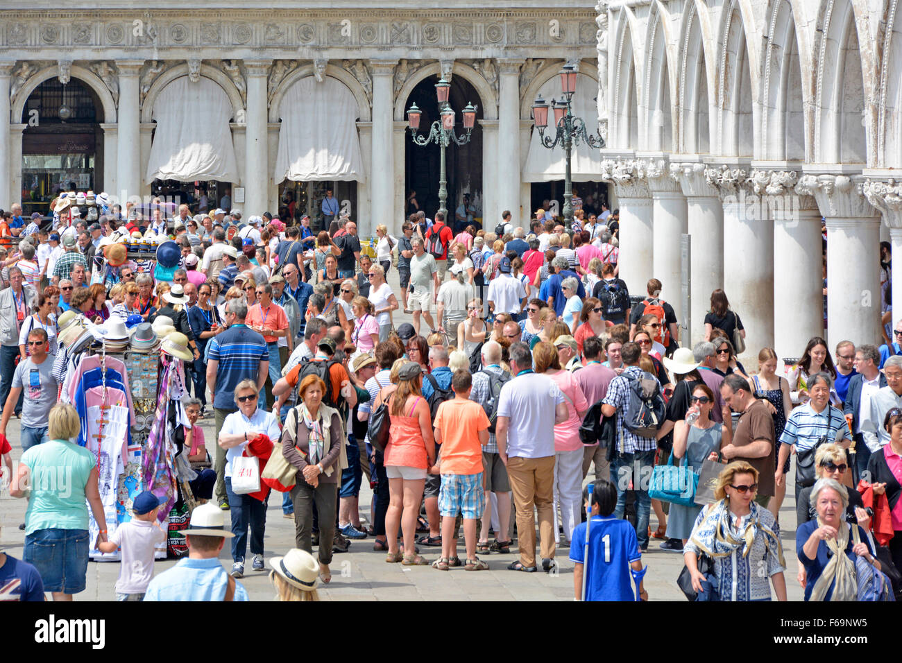 Venice crowd of people on the Riva degli Schiavoni promenade Italy Venice on a hot summers day - Stock Image