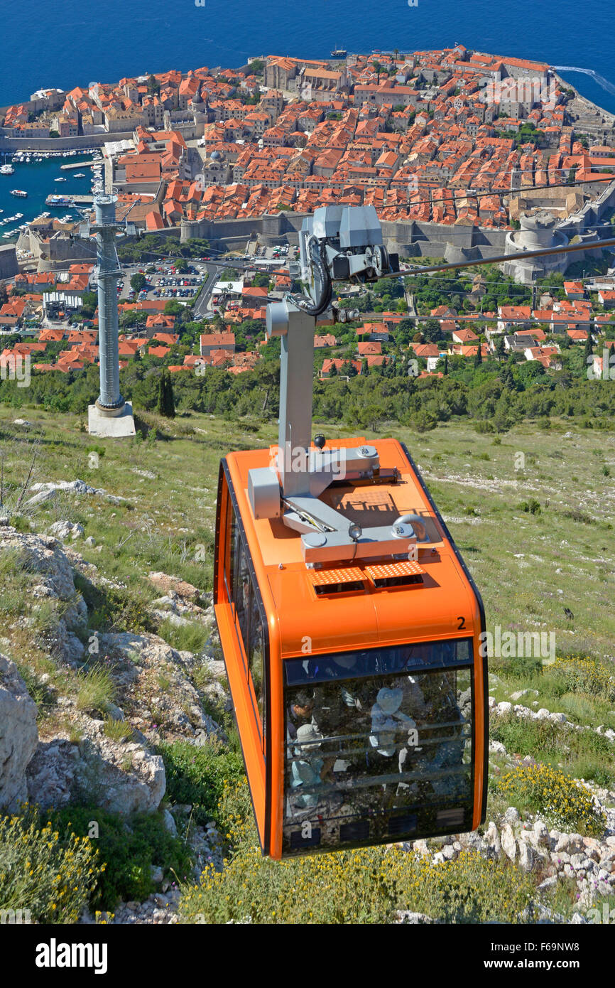 Dubrovnik Croatia Cable Car loaded with passengers near the top of Srd Hill with views to old walled town & - Stock Image