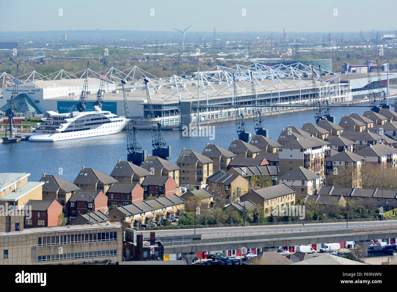 London aerial view of modern homes & Excel Exhibition Centre built around Royal Victoria Dock part of London - Stock Image