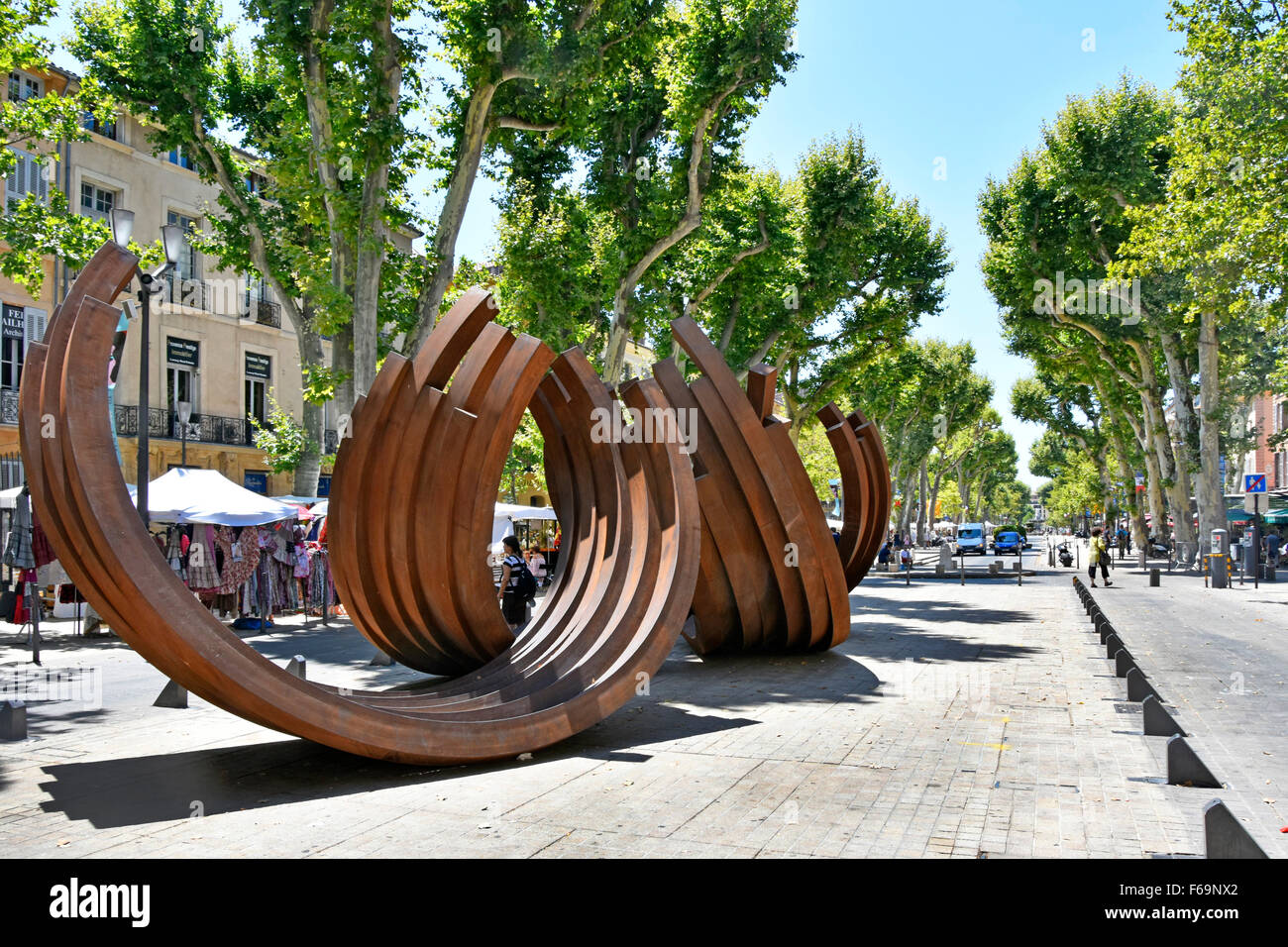 Aix en Provence South of France view of Cours Mirabeau boulevard featuring modern Arc street sculpture by Bernar - Stock Image