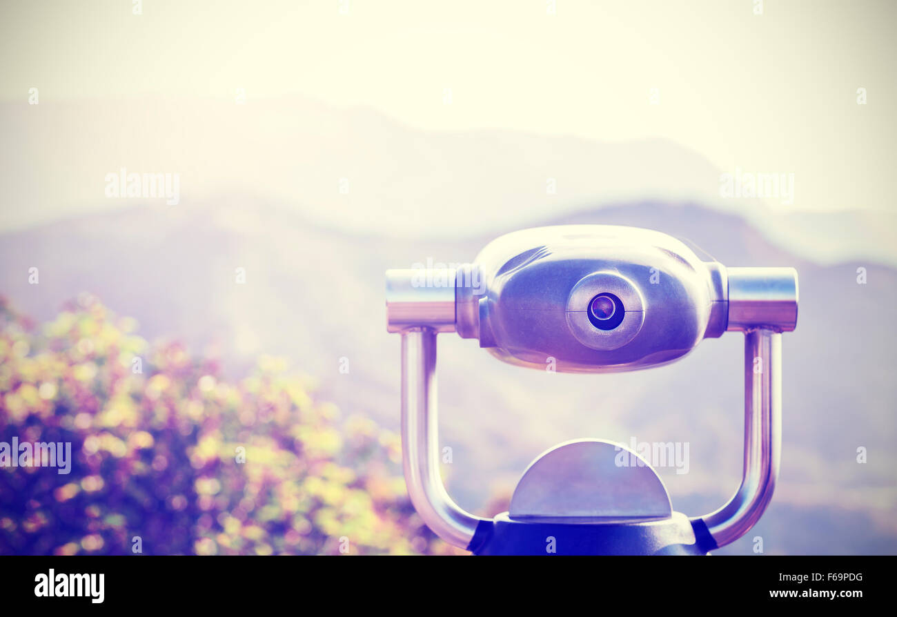 Vintage toned monocular pointed at horizon, shallow depth of field. - Stock Image
