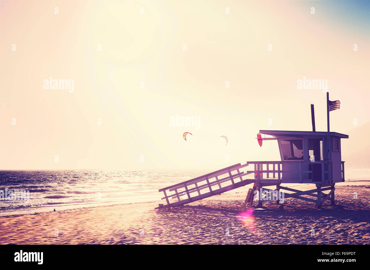 Vintage filtered lifeguard tower at sunset with lens flare effect, USA. - Stock Image