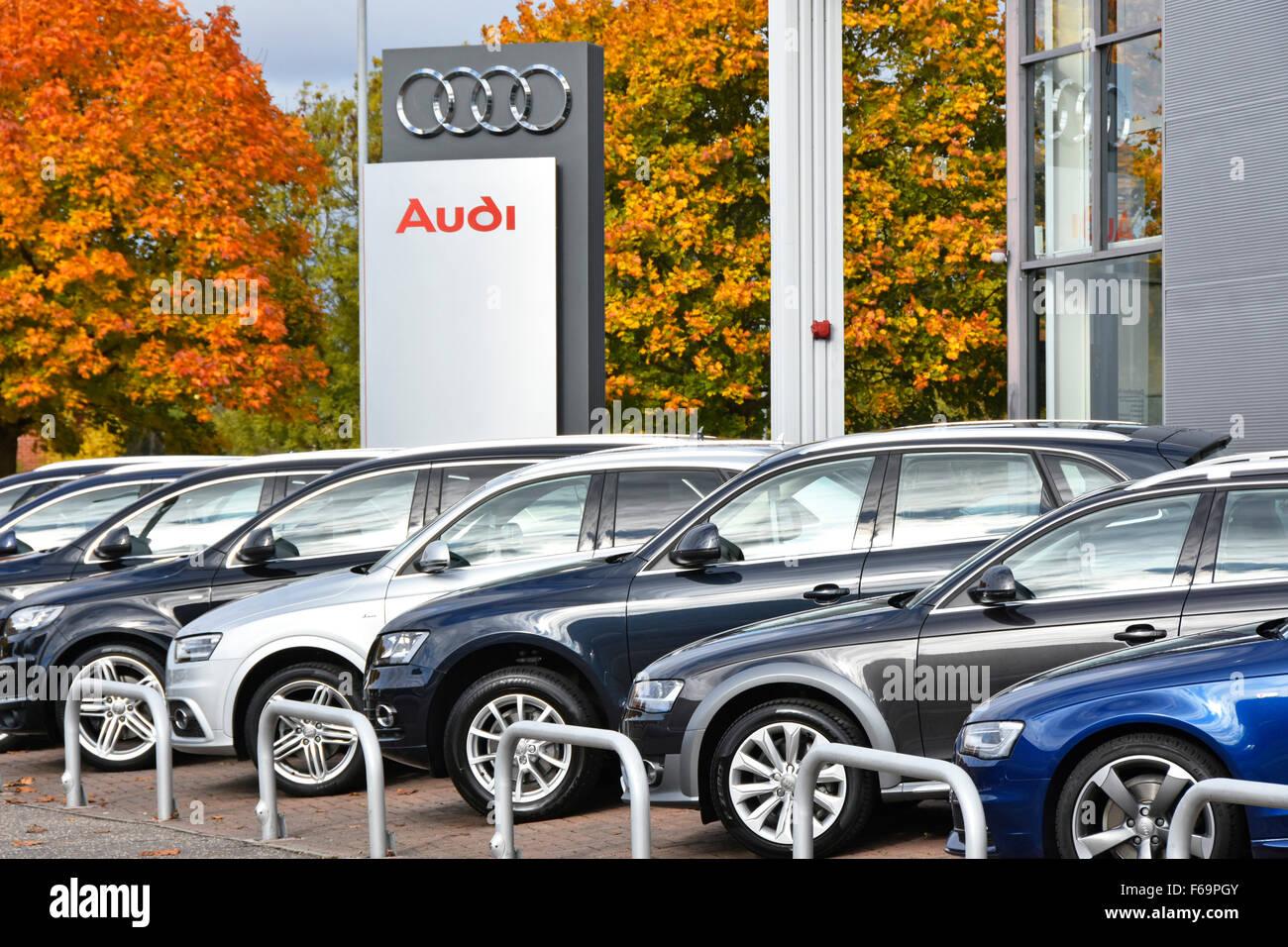 Car dealership Audi car dealer sign with cars for sale outside car showroom on forecourt Essex England UK end of - Stock Image