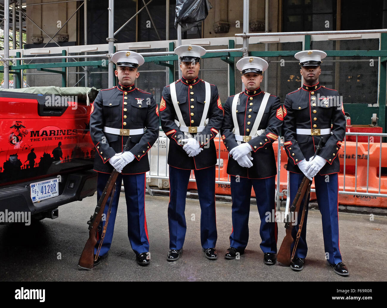 Four United States Marines in uniform prior to the 2015 Veteran's Day parade in New York City - Stock Image