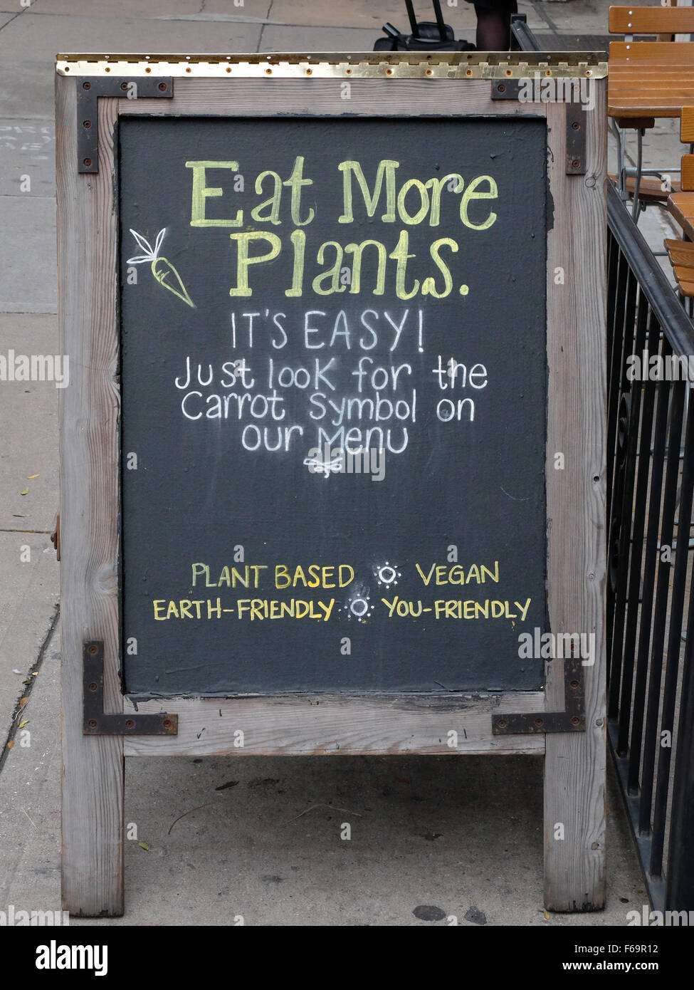 A sign outside the restaurant Le Pain Quotidien in Greenwich Village encouraging healthy vegetarian eating. New - Stock Image