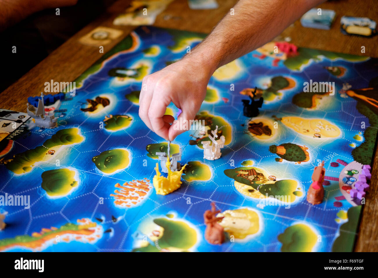 people playing a board game in a traditional pub england uk - Stock Image