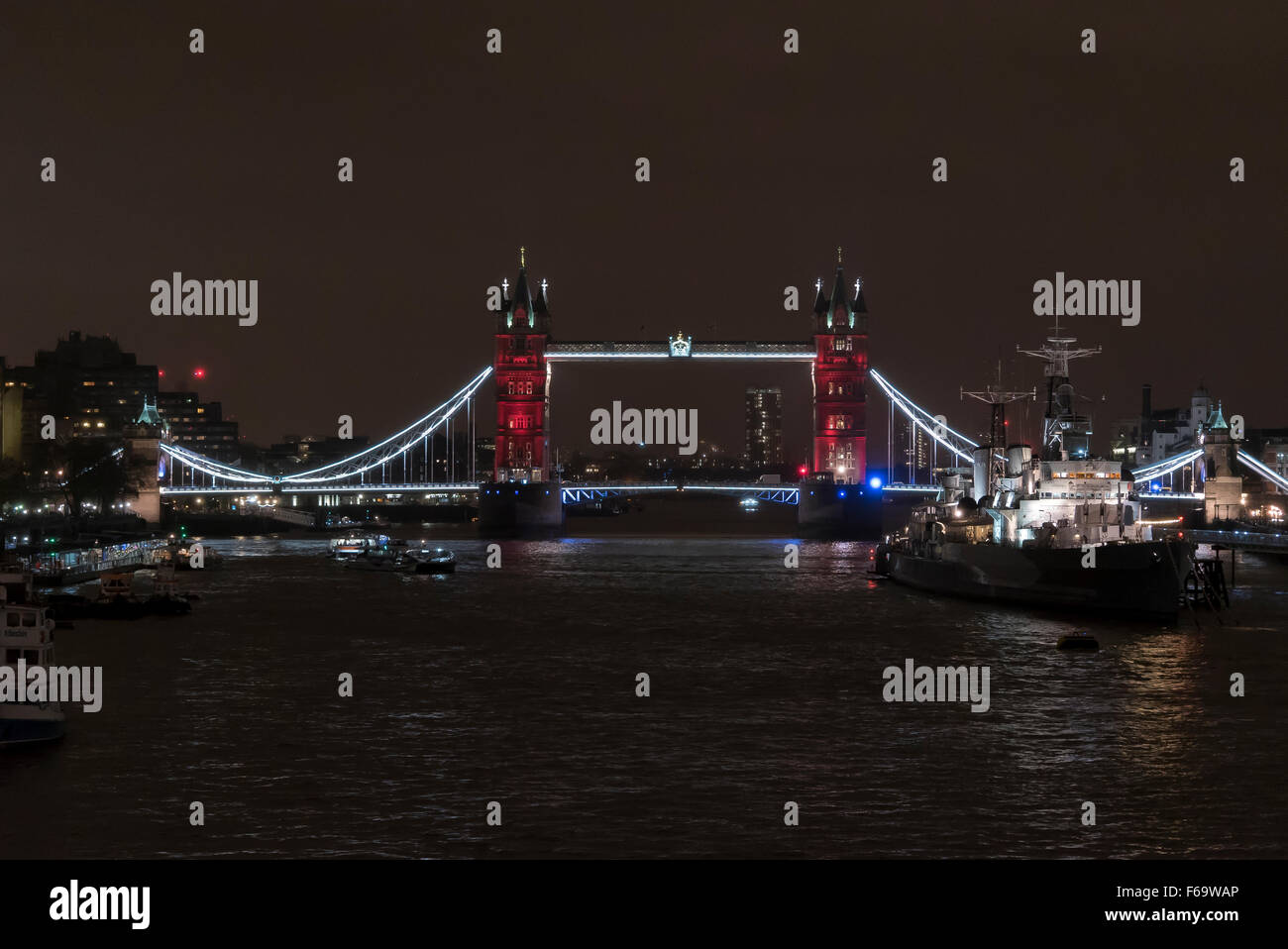 November 14th 2015: London's Tower Bridge is lit in blue, white and red in support with Paris attacks on 13th - Stock Image