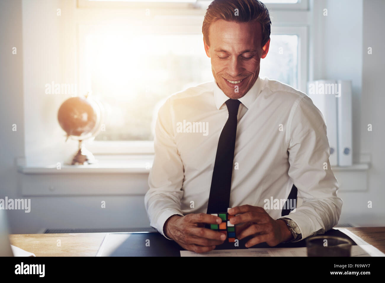 Successful executive business man sitting at his office getting ideas - Stock Image