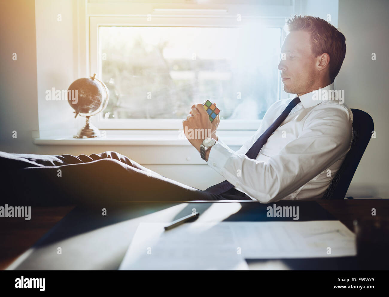 Executive business man solving problems and getting ideas for new business concepts - Stock Image