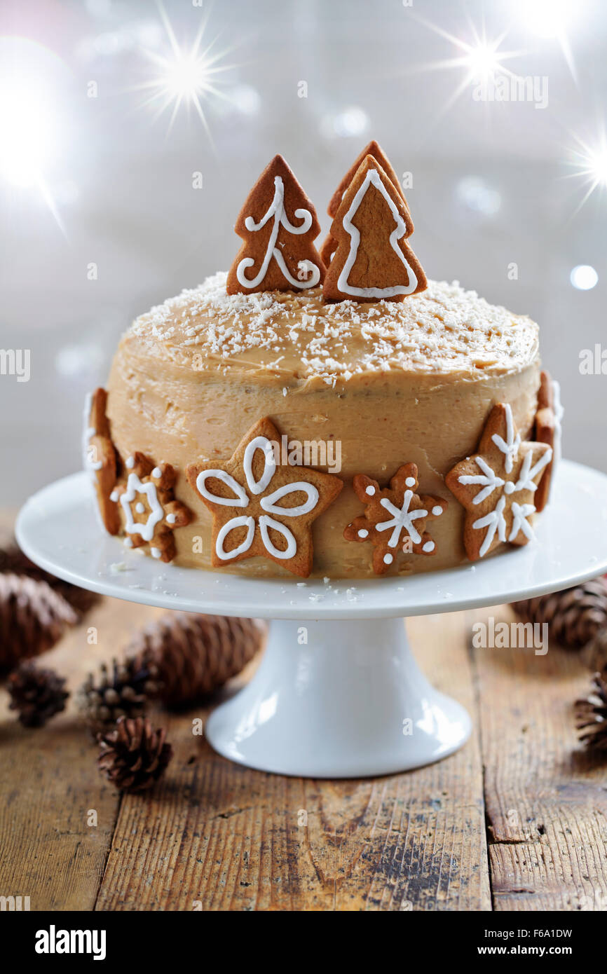 Ginger cake with gingerbread decorations - Stock Image