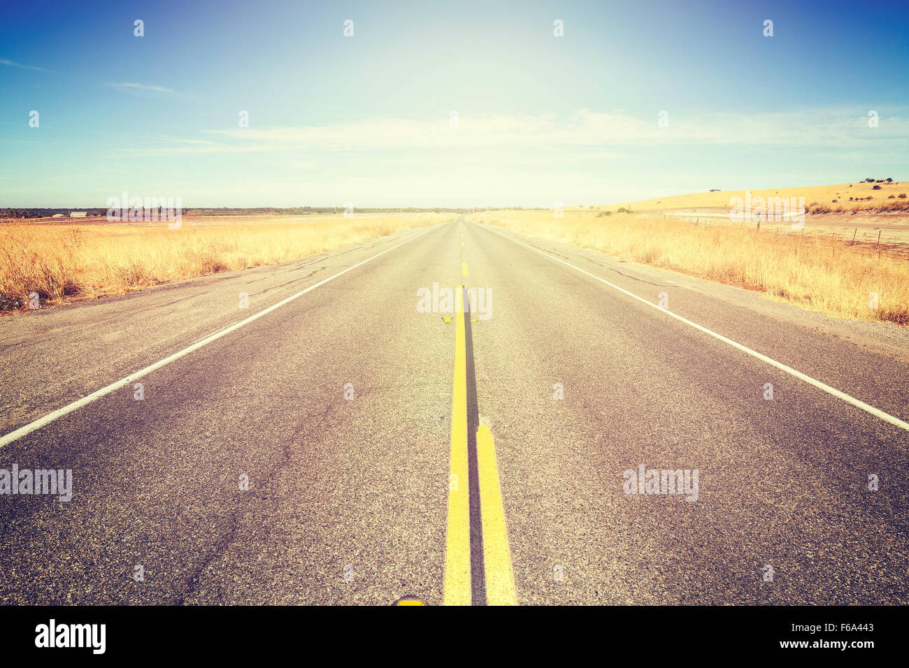 Vintage toned endless country road, travel concept picture. - Stock Image