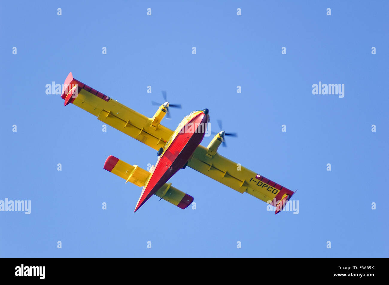 Bombardier/Canadair CL-415 firefighting sea plane of the Italian Protezione Civile during a firefighting mission - Stock Image