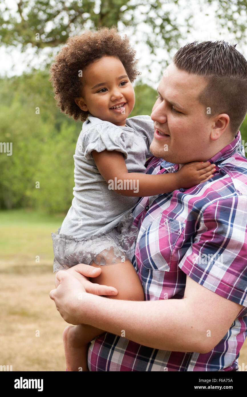 Blank father with his african daugther having a nice time - Stock Image