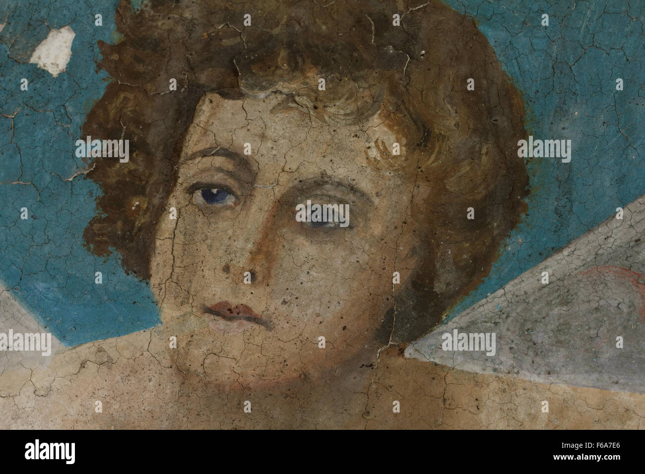 Closeup of the decrepit angelic character face part of the wallpainting entitled 'Artemis' by M. Papamalis. - Stock Image