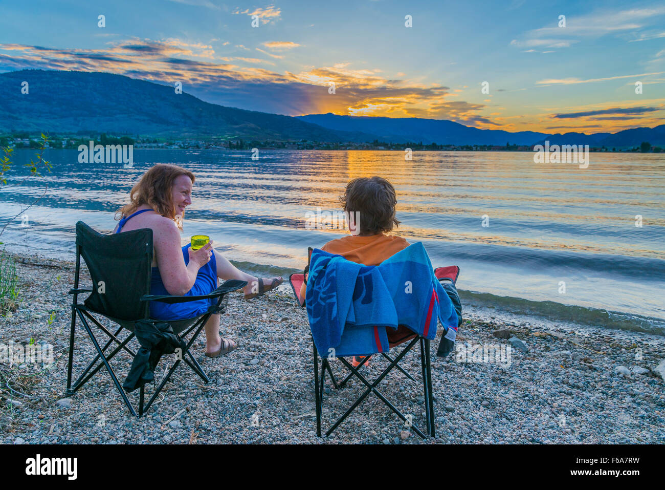 Mother and son at  at lakeshore campsite, Haynes Point Provincial Park, Osoyoos, British Columbia, Canada - Stock Image