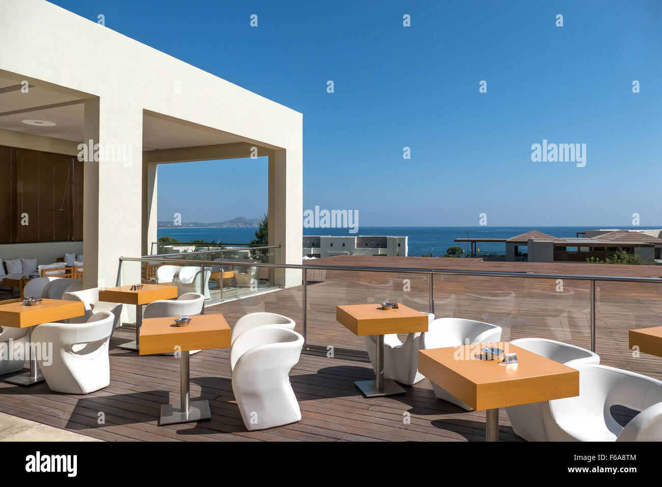 Modern and contemporary outside bar seating and tables. - Stock Image