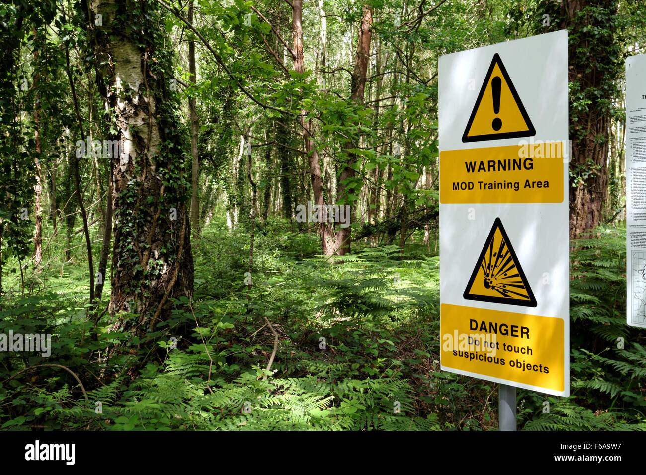 MOD warning signs on army training area in Aldershot Hampshire UK - Stock Image