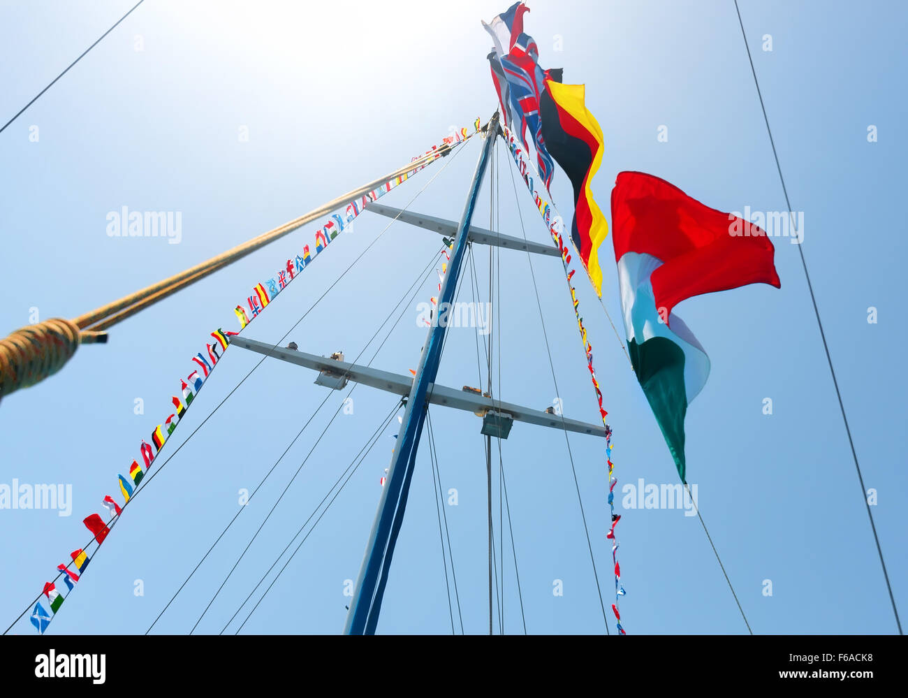 Flags of different countries on the mast of sailboat - Stock Image