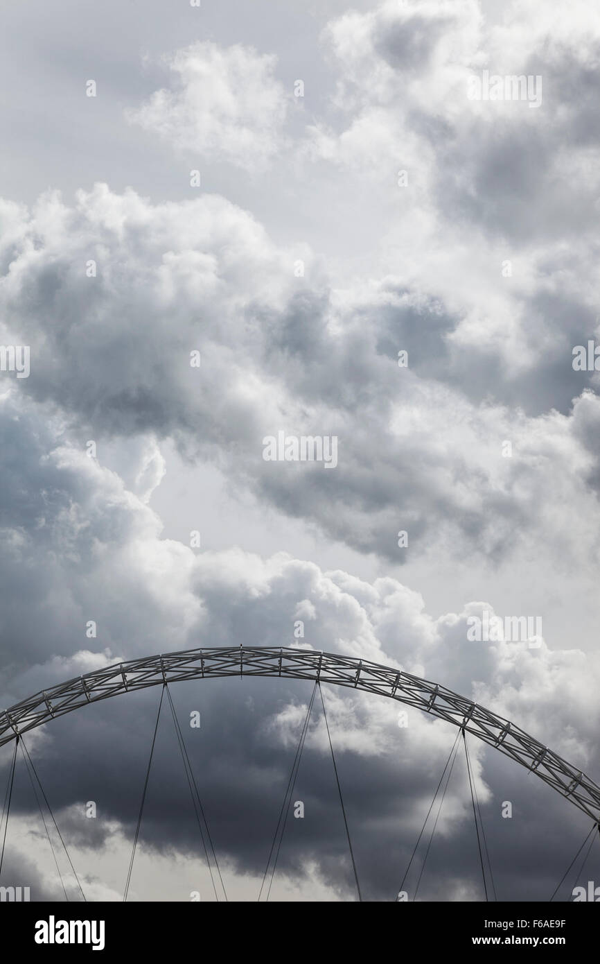 The arch of Wembley Stadium against a cloudy sky, London, UK - Stock Image