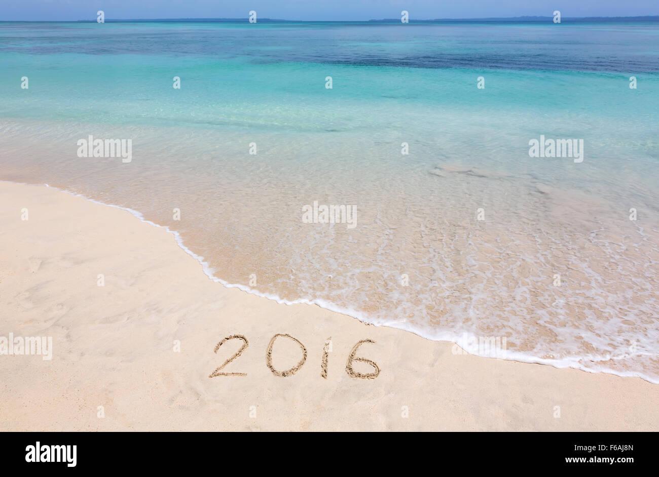 Happy New Year 2016 creative on the beach - Stock Image