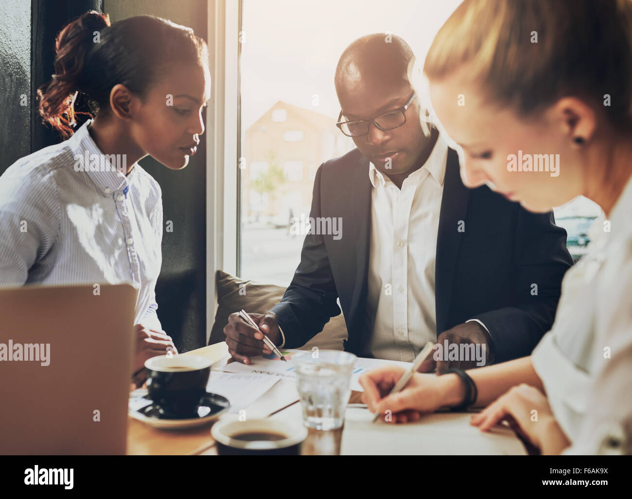Serious group of business people working, multi ethnic group, business, entrepreneur, start up concept - Stock Image