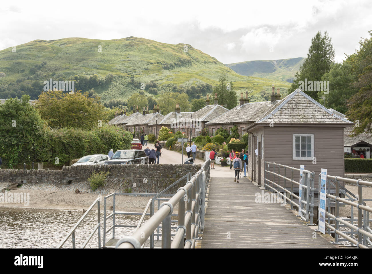 Traditional Scottish cottages seen from the Pier - Luss, Loch Lomond, Scotland - Stock Image
