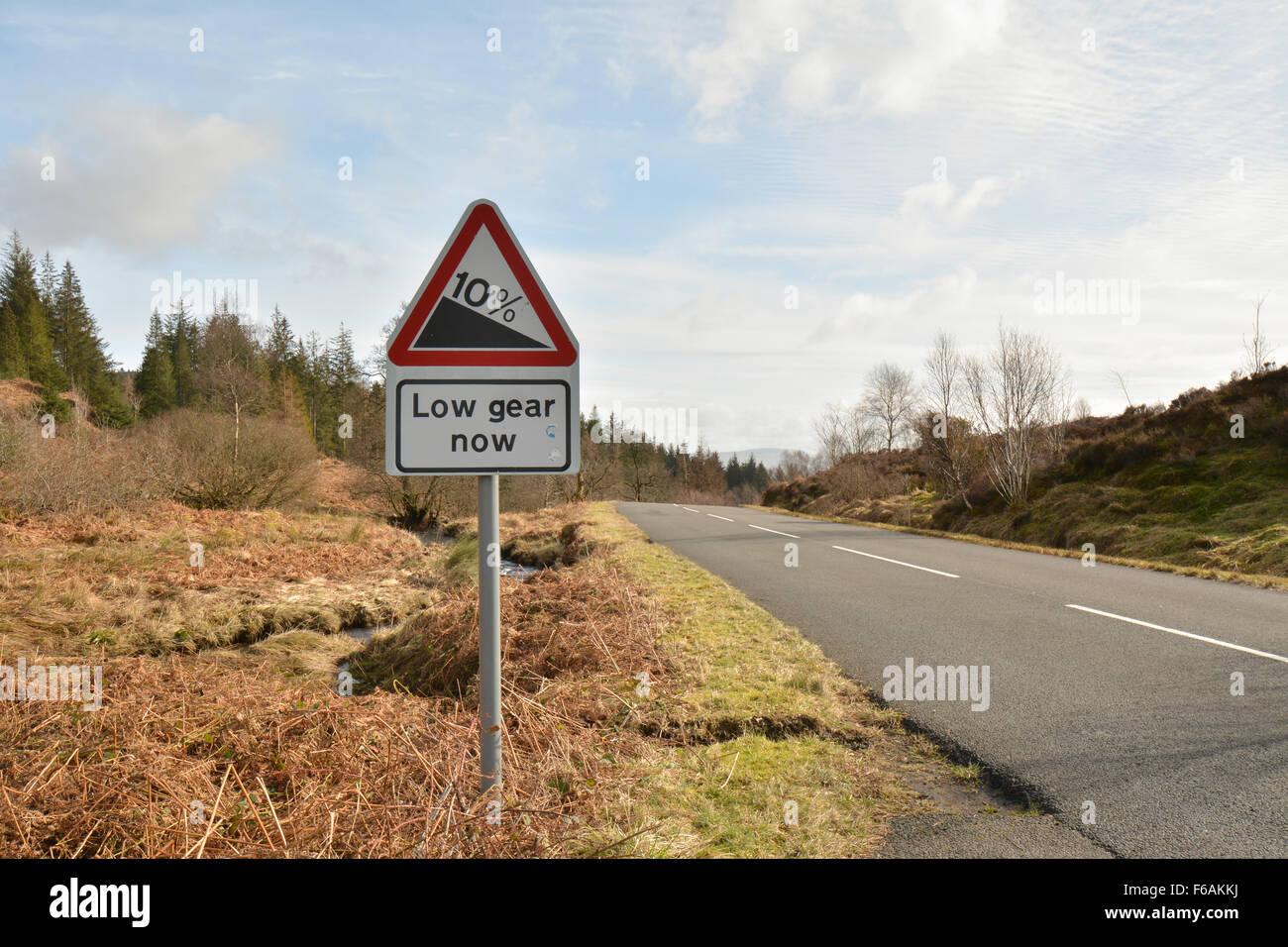 Dukes Pass, Trossachs, Scotland, UK - 10% gradient road sign, low gear now - Stock Image
