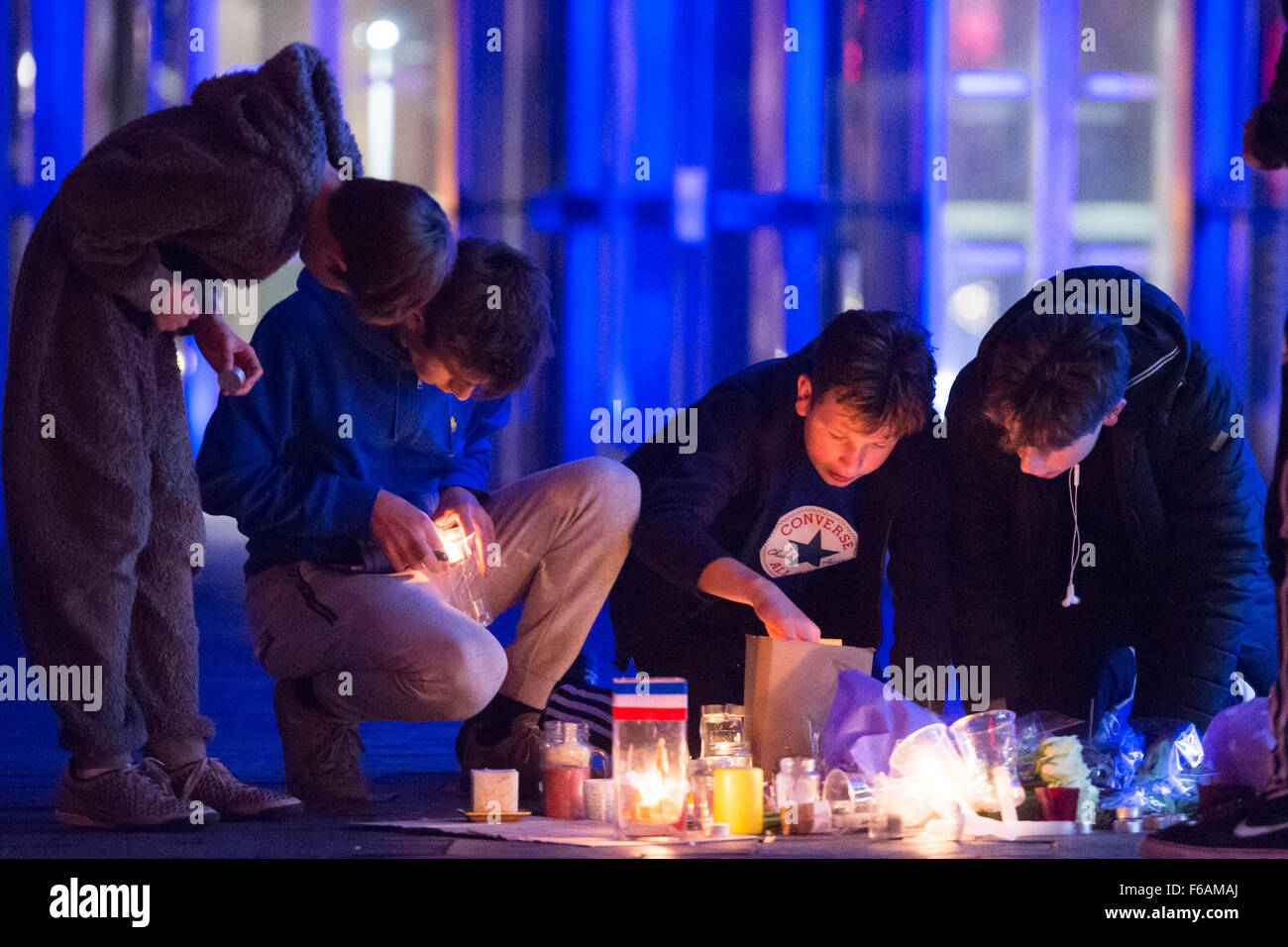 A vigil is held to Paris terrorist attack victims at the Senedd, Cardiff Bay, Wales. - Stock Image