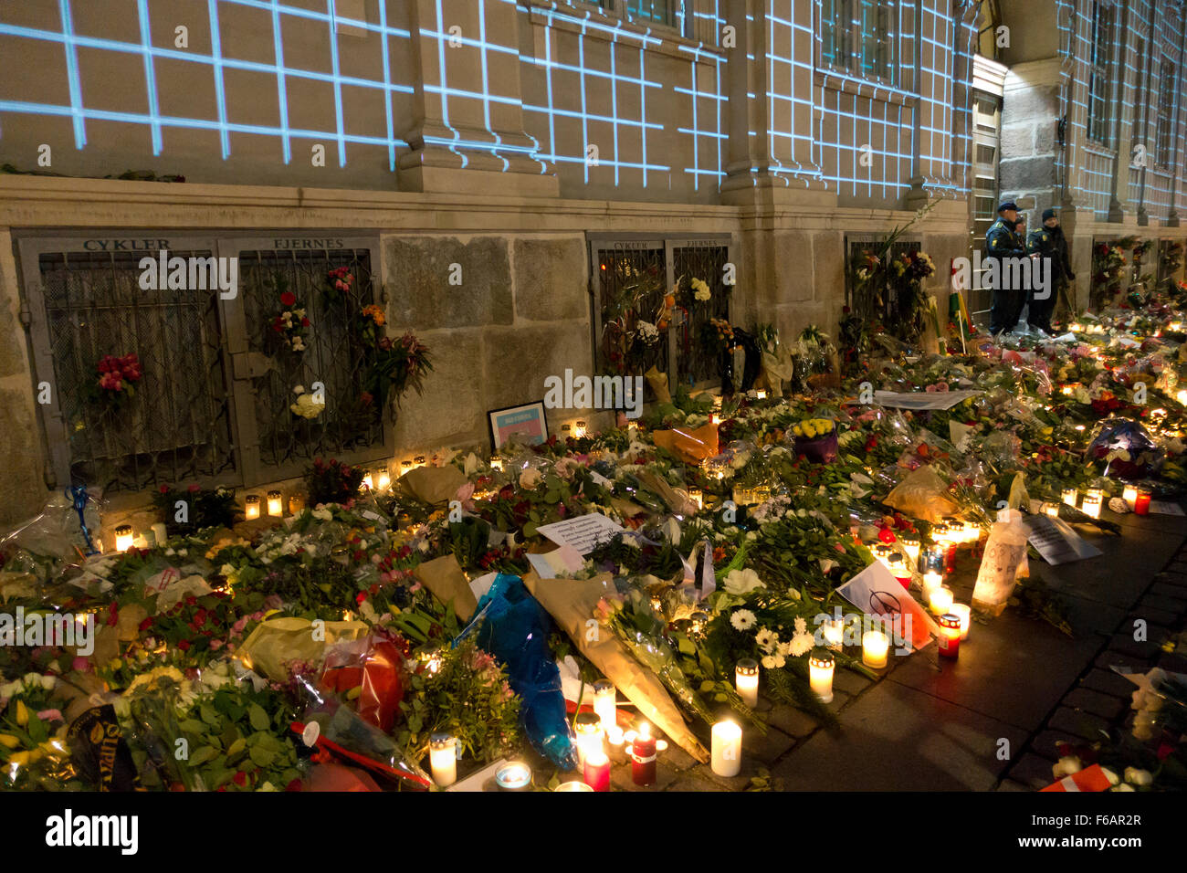 Copenhagen, Denmark, 15th November, 2015. Thousands of people in Copenhagen show their solidarity and sympathy with the French people outside the French Embassy in Copenhagen after last Friday's terror attacks in Paris. The huge amount of flowers and messages still grows on the flower beds this Sunday evening after the official memorial events in Copenhagen earlier today and official events and spontaneous actions all over Denmark. Credit:  Niels Quist/Alamy Live News Stock Photo