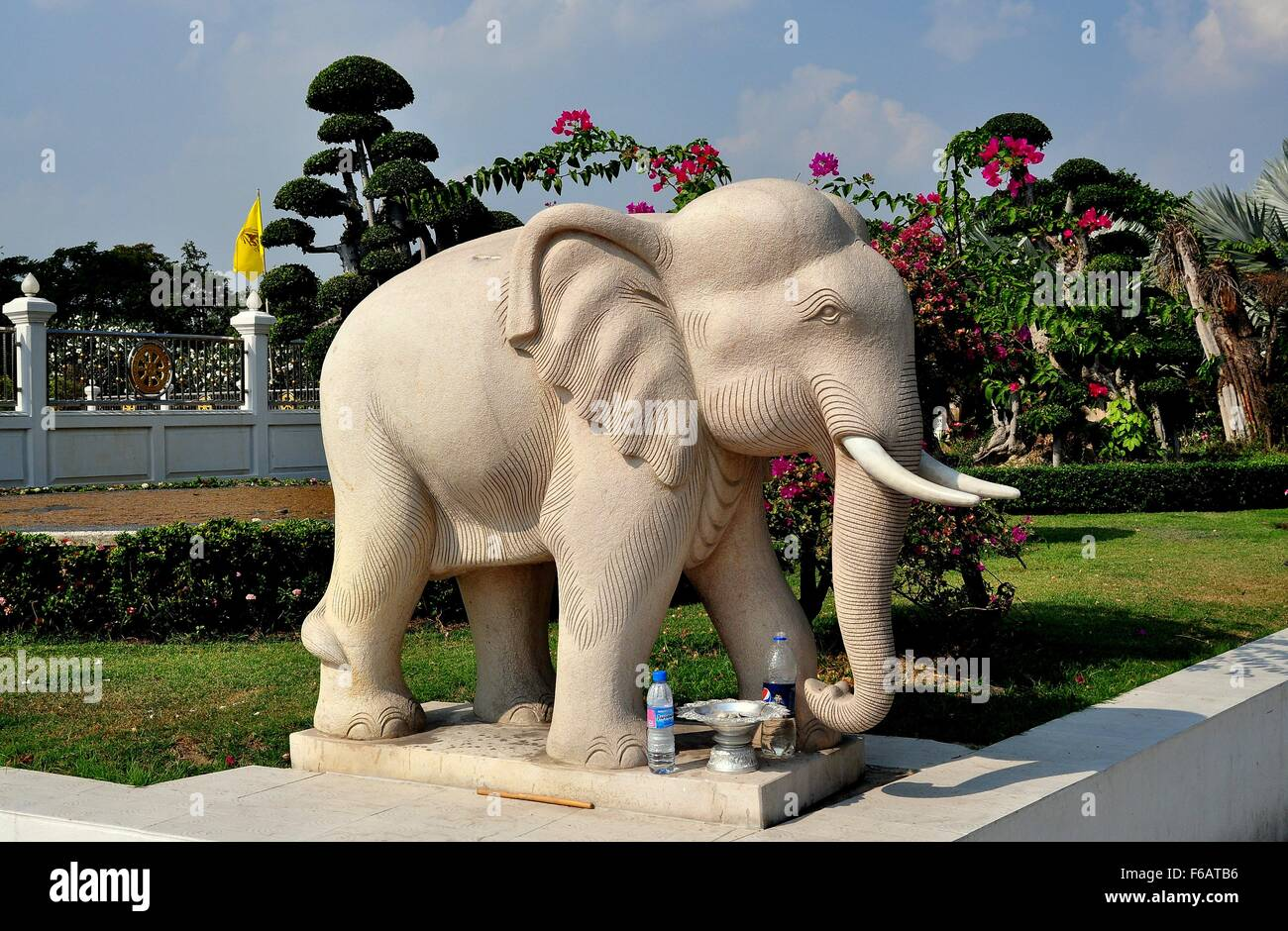 Samut Prakan, Thailand: Statue of a revered Thai elephant complete with two plastic bottles of water left as offerings - Stock Image
