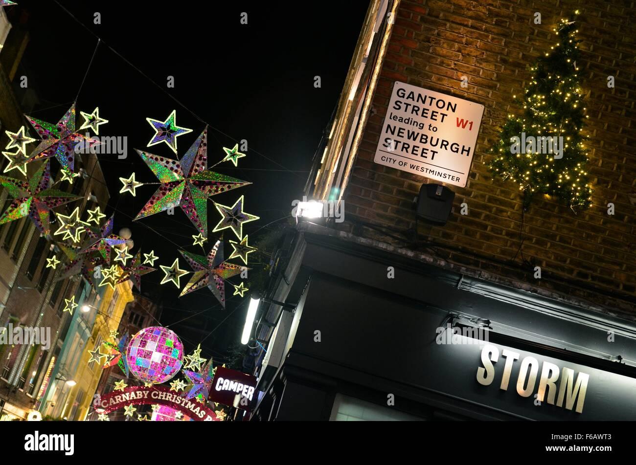 Christmas lights on Carnaby Street as seen from Ganton Street, London, England, UK - Stock Image