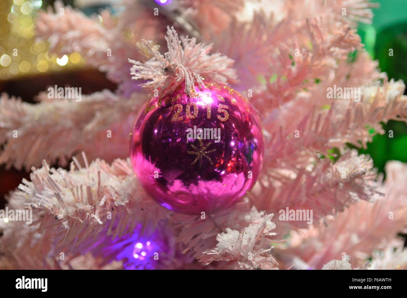 2015 Christmas Bauble On A Pink Christmas Tree In The Window Of