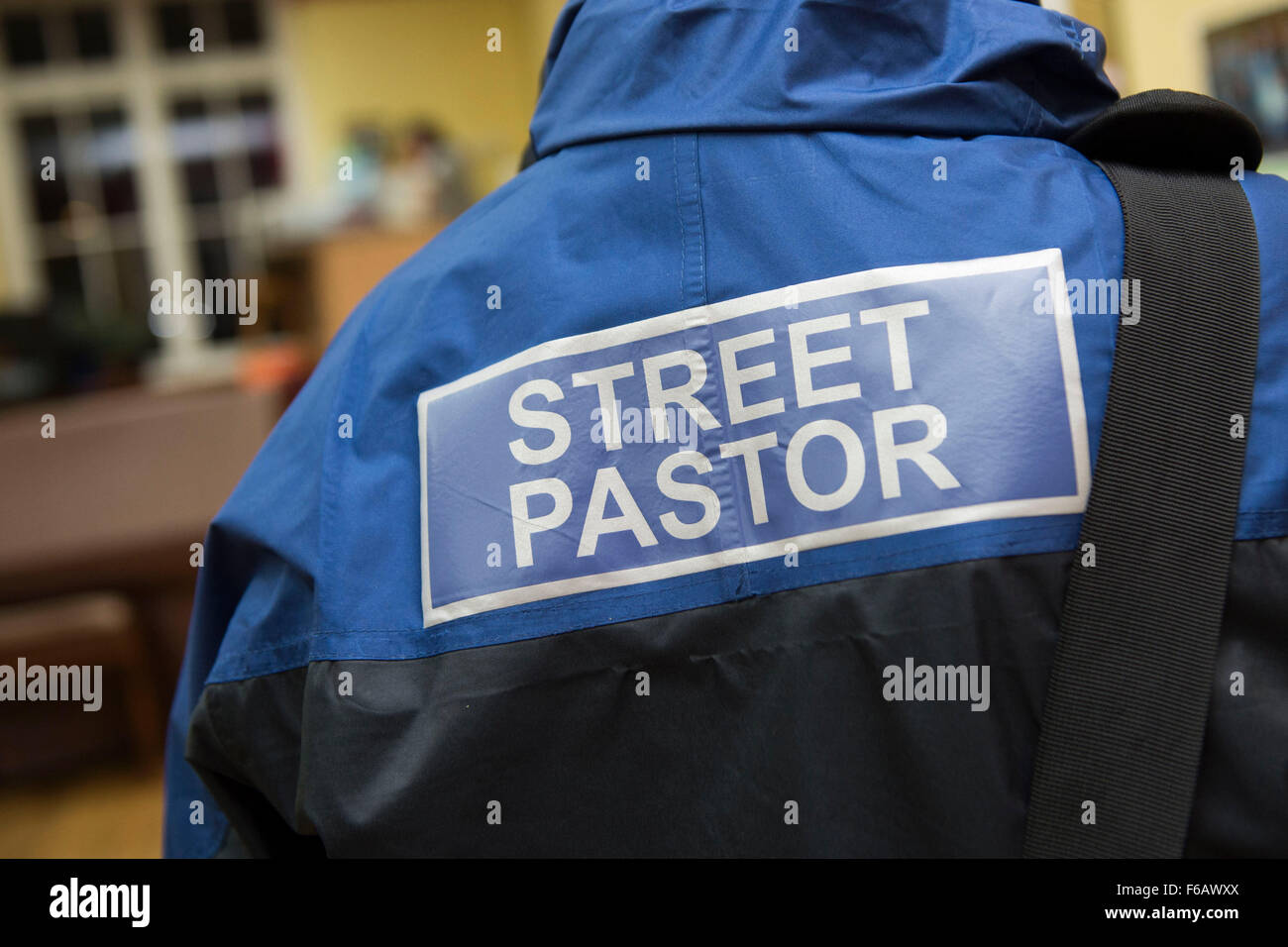A street pastor at work in Cardiff, South Wales. - Stock Image