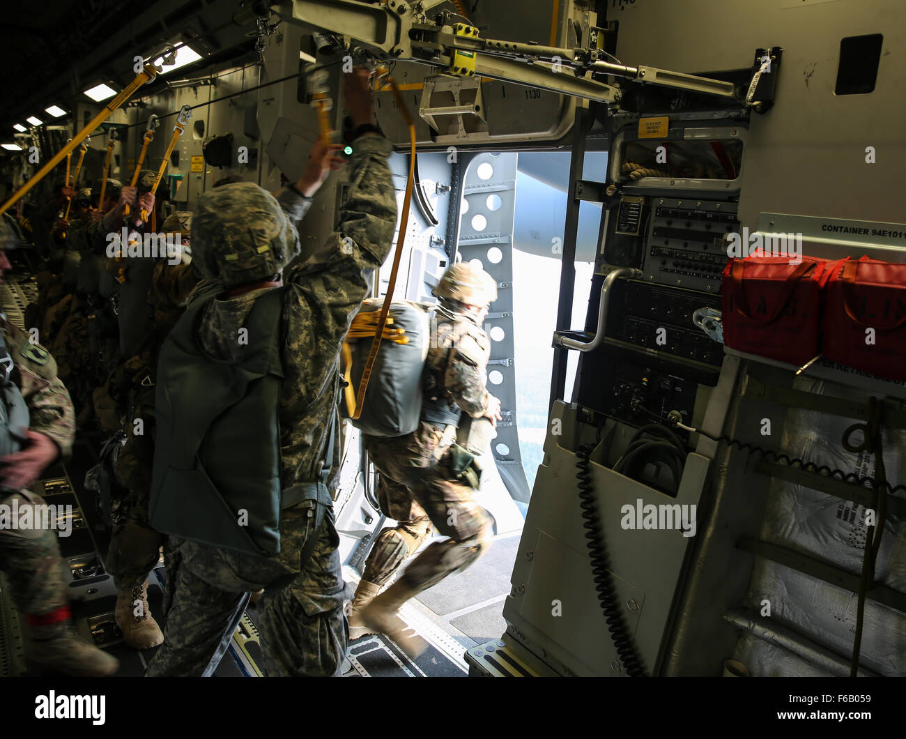 U.S. Soldiers assigned to the 173rd Airborne Brigade Combat Team jump from a Boeing C-17 aircraft while conducting - Stock Image