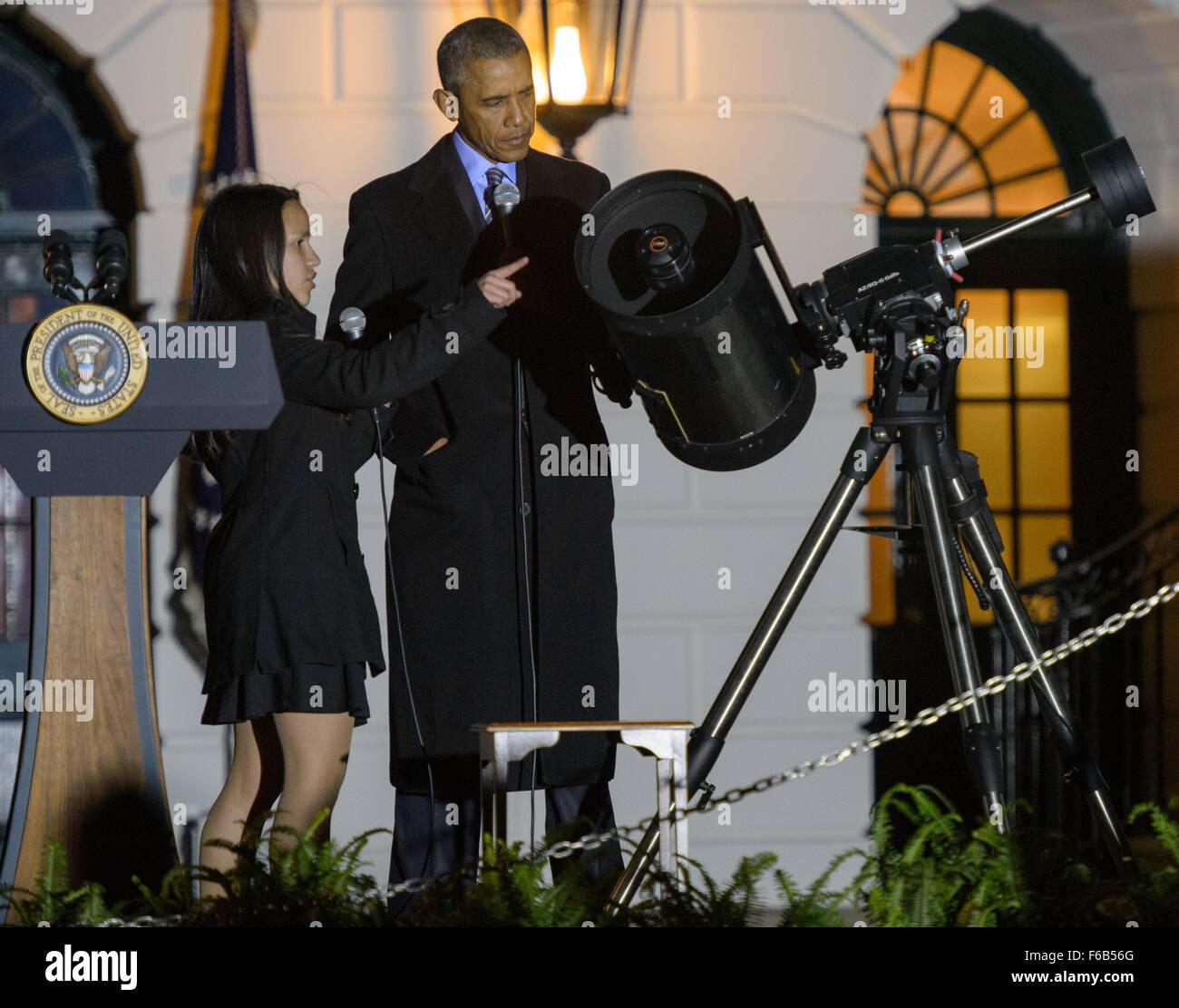 Agatha Sofia Alvarez-Bareiro, a student from Brooklyn, NY, left, points out parts of a telescope to President Barack - Stock Image