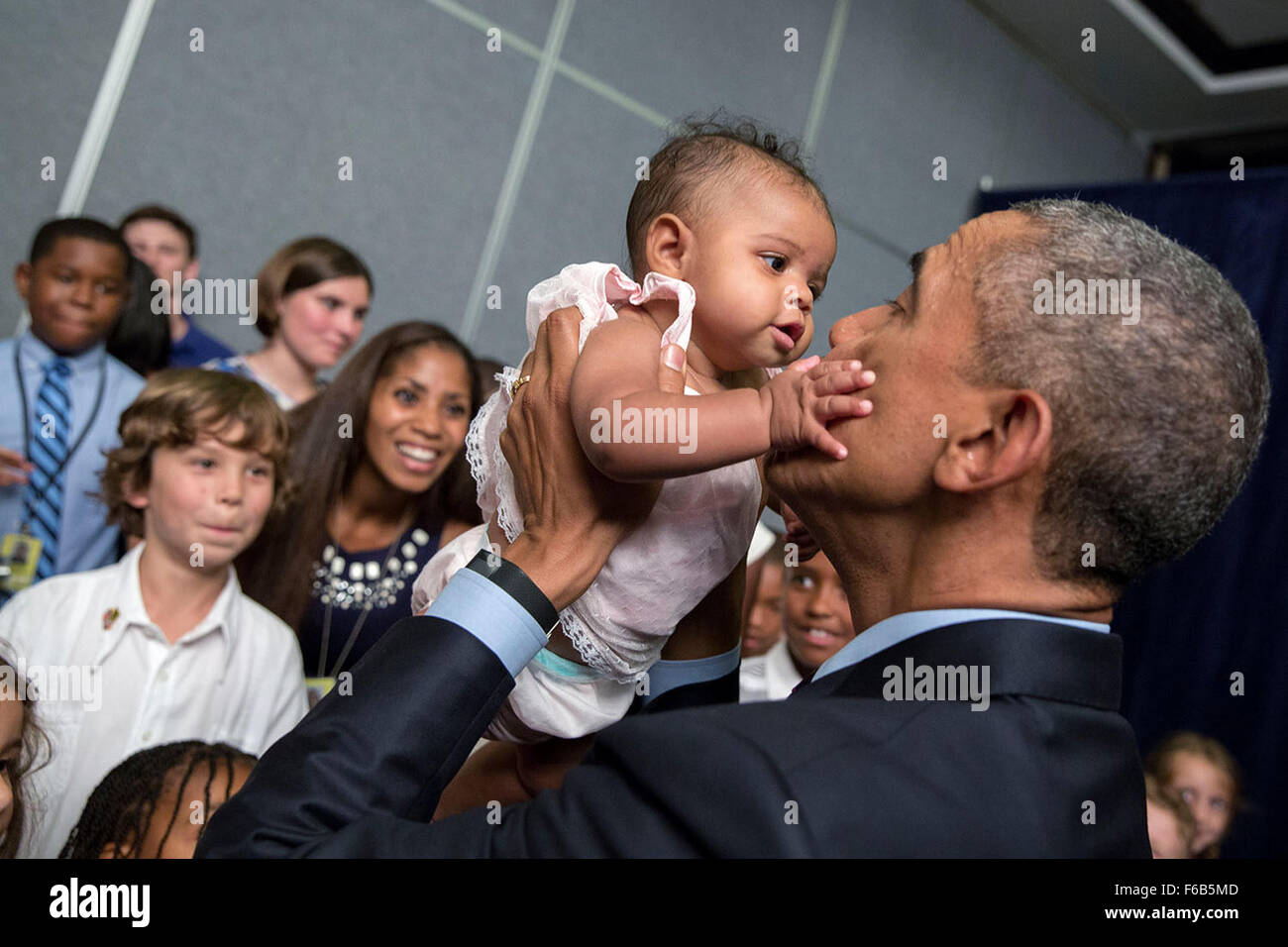 President barack obama holds a baby during a us embassy meet and president barack obama holds a baby during a us embassy meet and greet in kingston jamaica april 8 2015 m4hsunfo