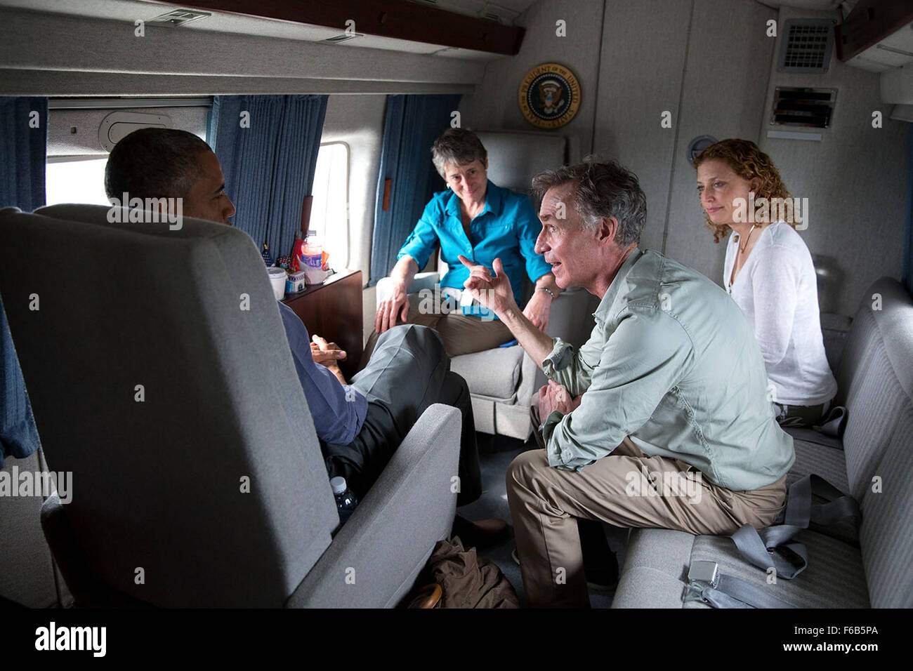 President Barack Obama talks with Bill Nye, the Science Guy, Rep. Debbie Wasserman Schultz, D-Fla., and Interior Secretary Sally Jewell aboard Marine One en route to Miami International Airport following a visit to Everglades National Park, Fla. on Earth Day, April 22, 2015. Stock Photo