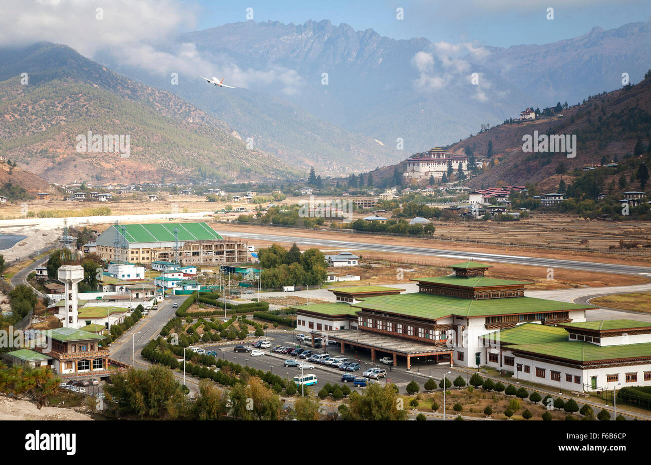 A jet takes flight from Paro airport over the Himalayas.  Bhutan. - Stock Image