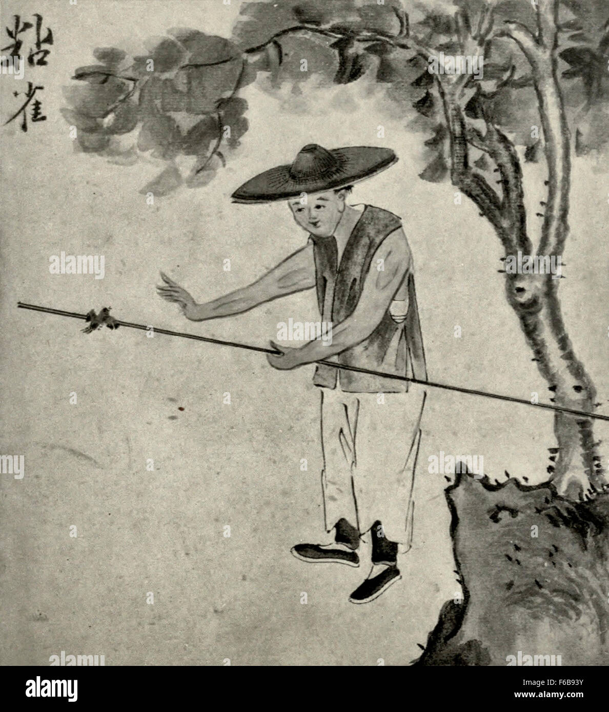 A Favorite Pasttime - Taming a bird - China 1890s - Stock Image