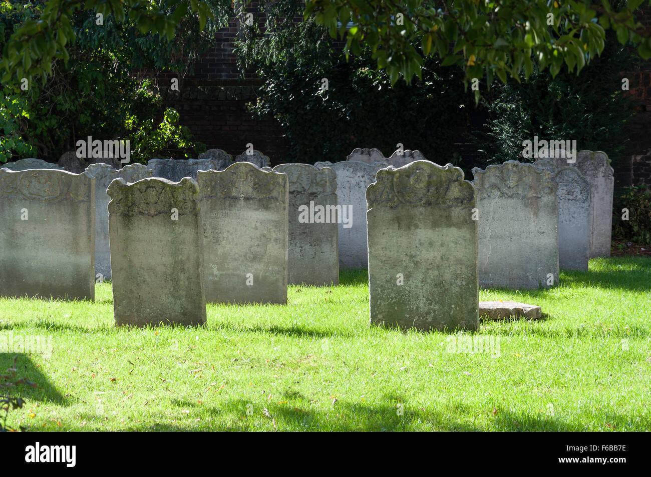 Headstones in churchyard of St Nicholas Church, London Road, Strood, Kent, England, United Kingdom - Stock Image