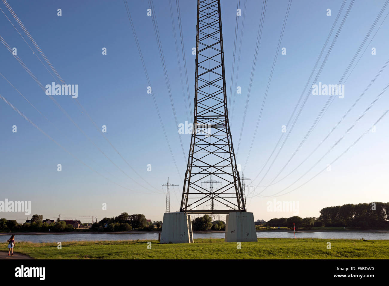 High-voltage electricity lines crossing the river Rhine, Rheindorf, Germany. - Stock Image