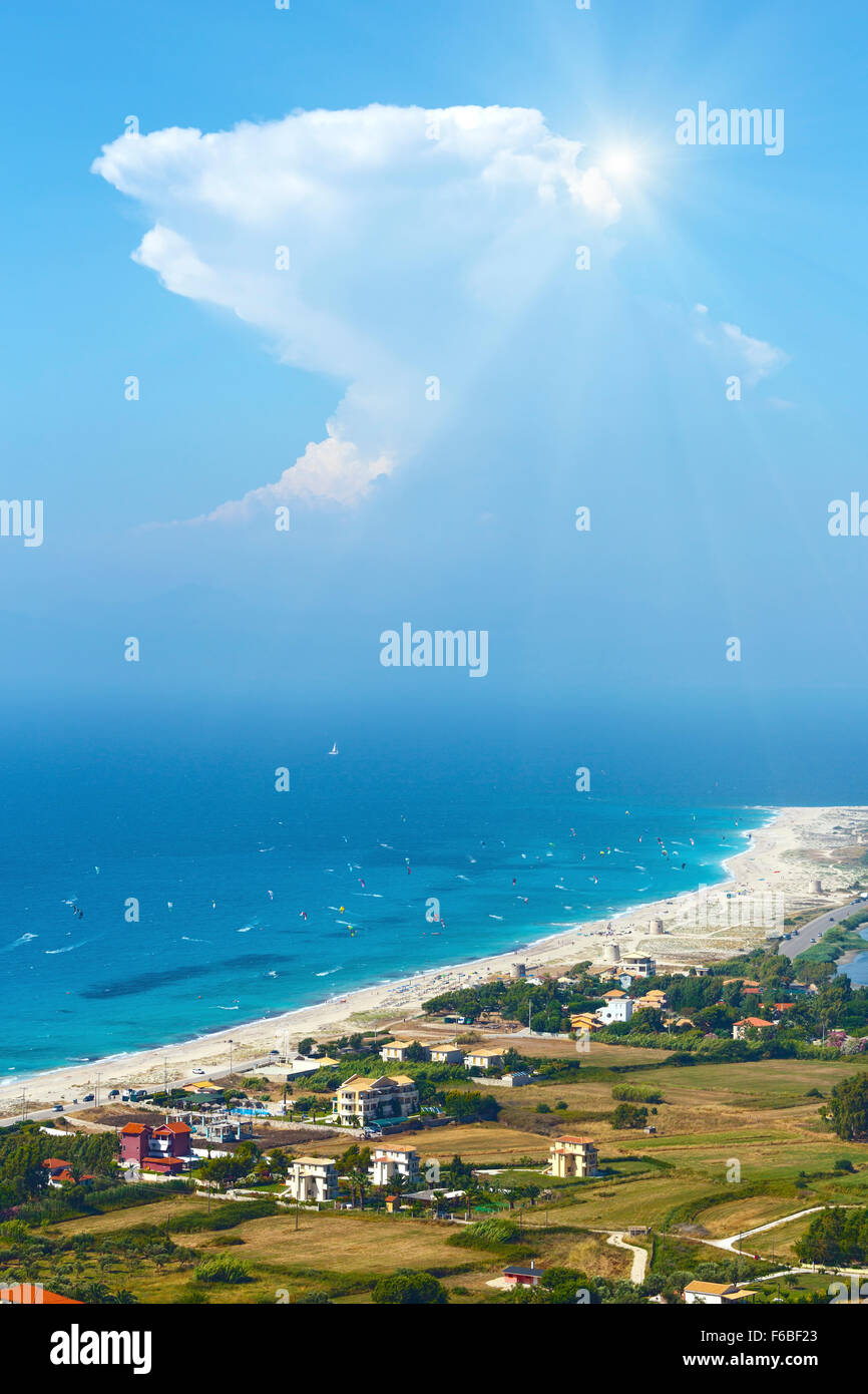 Beautiful summer Lefkada coast beach and kiteboarders (Greece, Ionian Sea,  view from up). All people are not identifiable. Stock Photo