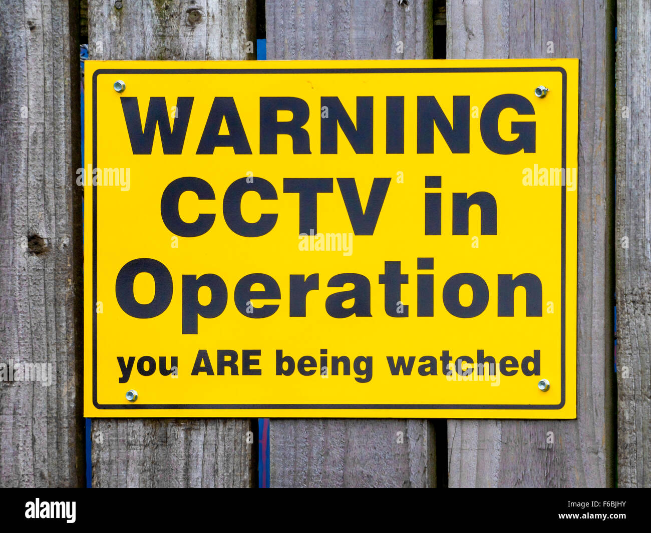 Notice warning of the presence of CCTV surveillance cameras Warning CCTV in operation you are being watched - Stock Image