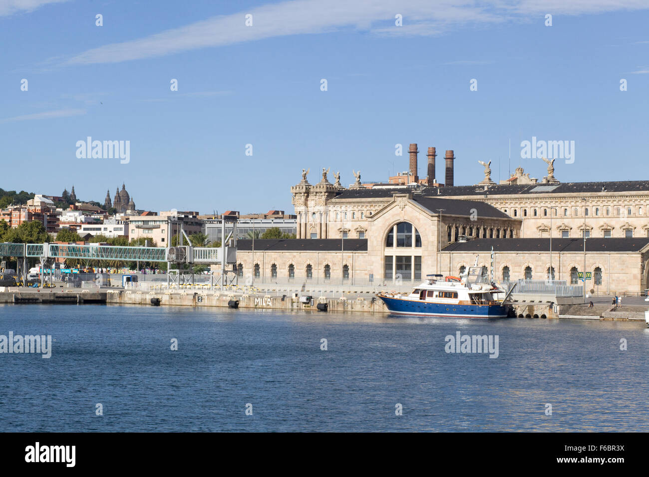 old Port Authority building with a police boat in the water - Stock Image