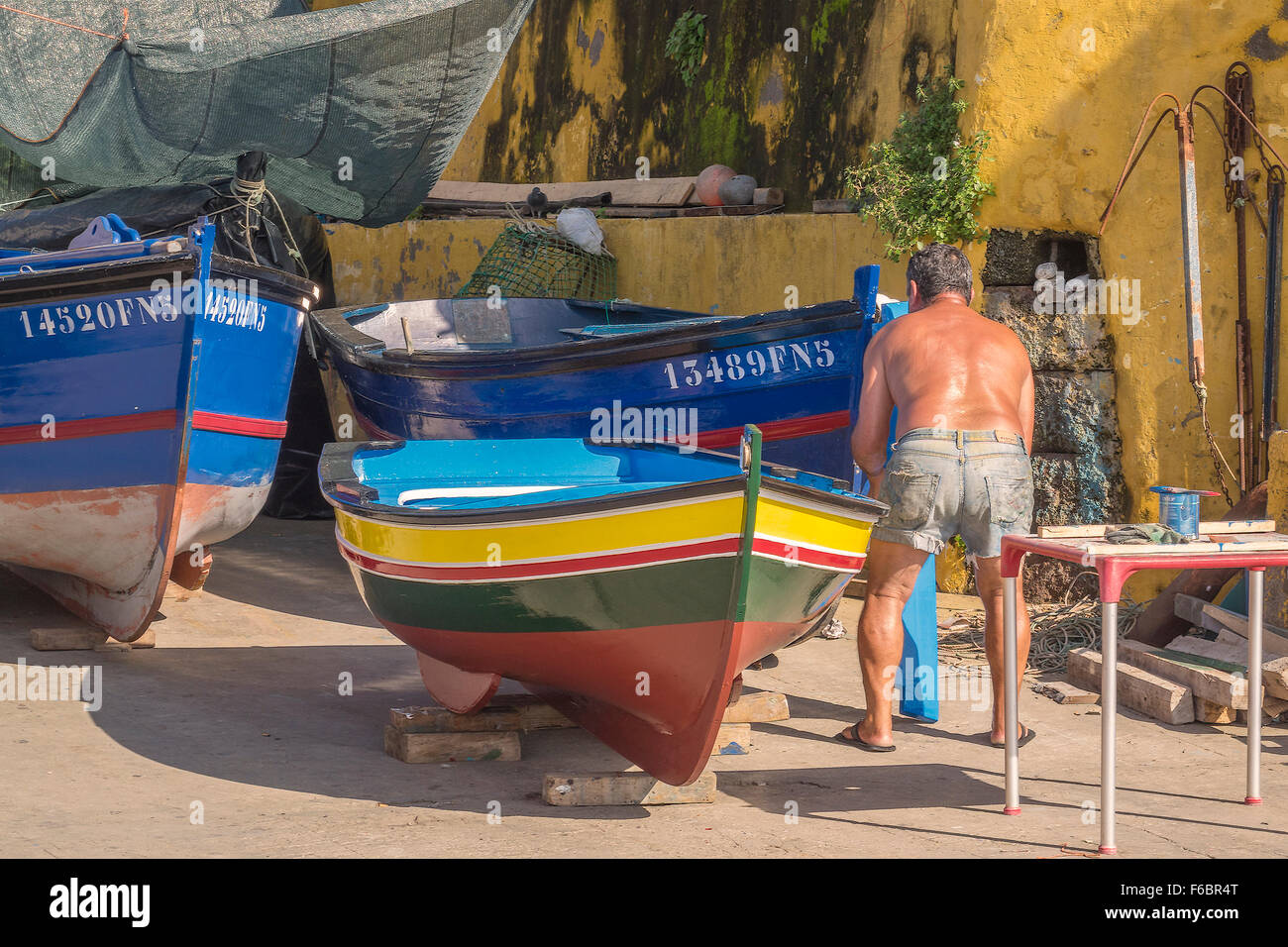Painter In The Boatyard Funchal Madeira Portugal - Stock Image