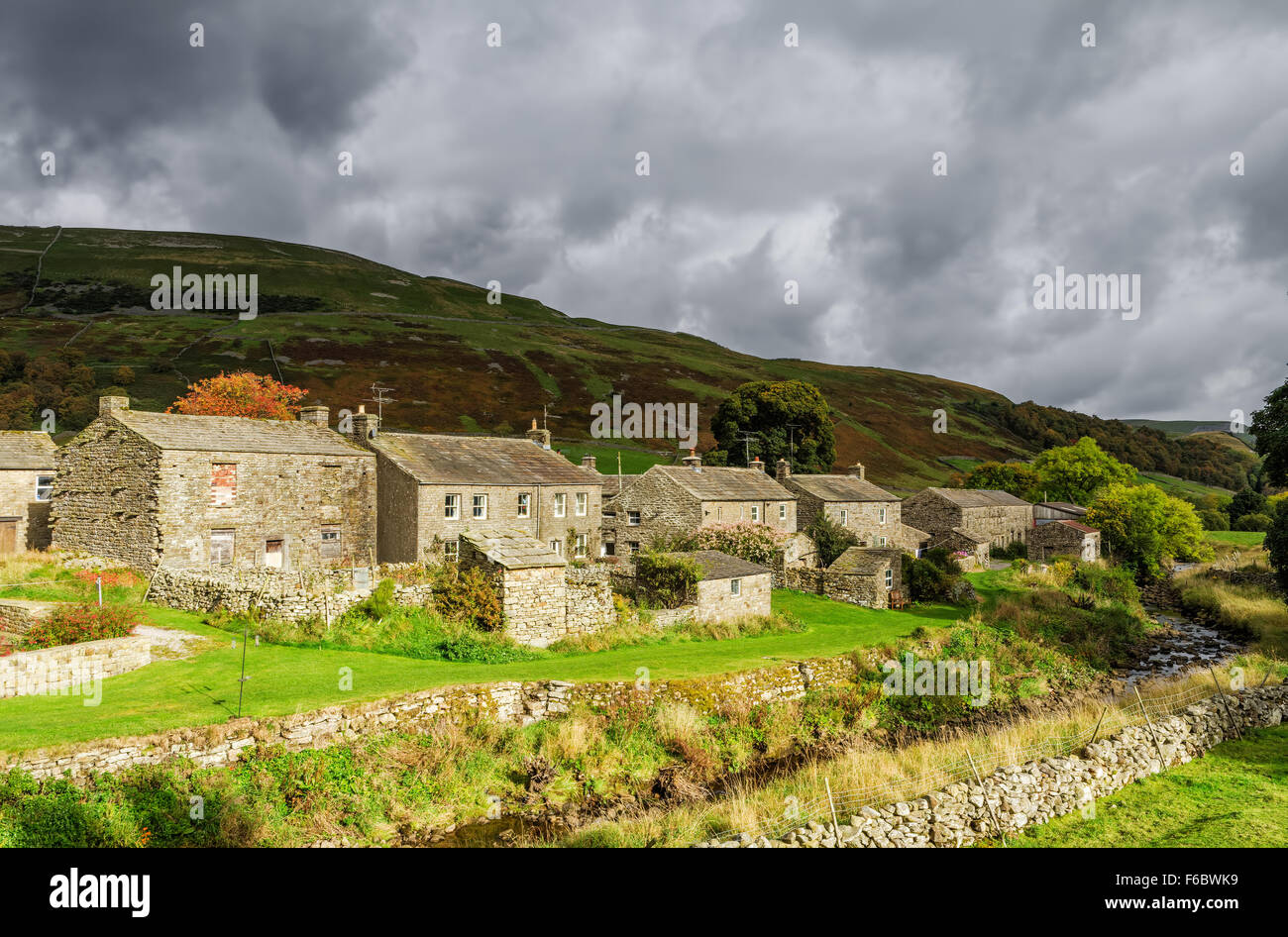 Stone cottages in Thwaite, England - Stock Image