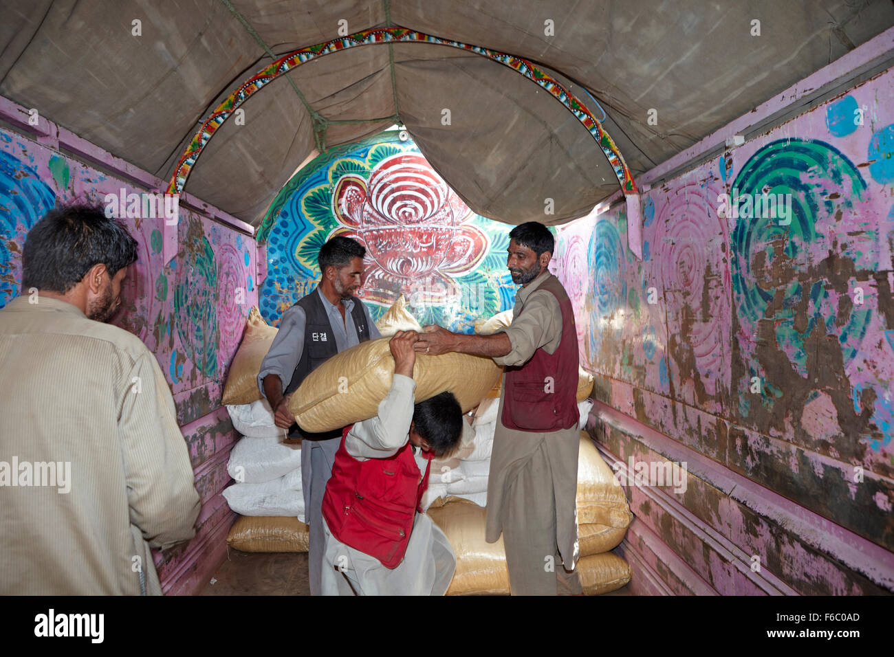 Porters unloading goods arrived in truck, uri, jammu & kashmir, india, asia - Stock Image